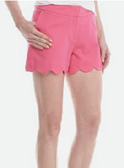 Woman wearing pink scallop-hem shorts. Shop shorts.
