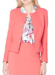 Woman wearing suit with printed blouse. Shop suits.