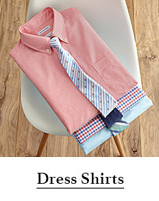 A stack of folded men's dress shirts in a variety of colors & prints. Shop dress shirts.