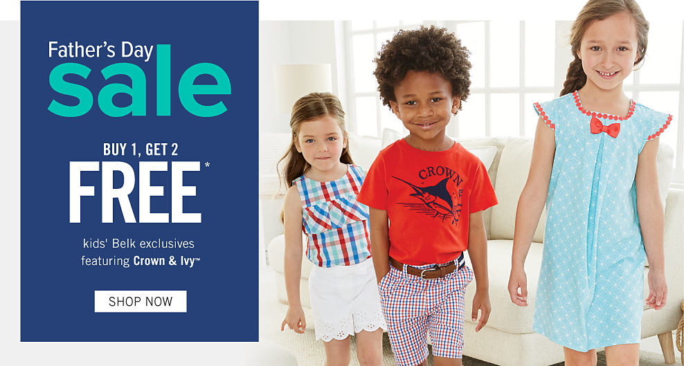 7cecc329768f7 A girl wearing a red, white & blue plaid sleeveless dress standing next to a