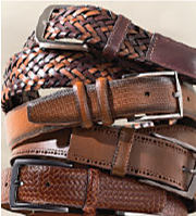 A selection of brown leather belts with different textures.