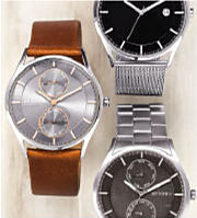 Three men's watches in varying colors and band materials.