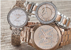 A stack of three women's watches with various gold tones and rhinestone embellishments!