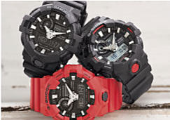 A stack of three sporty men's watches, in black and red.
