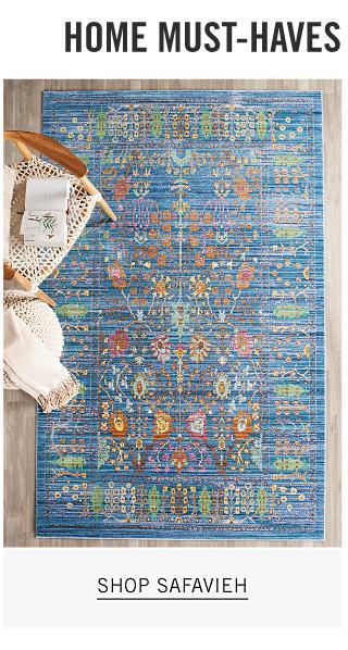 A multi colored print area rug on a wood floor. Shop Safavieh.