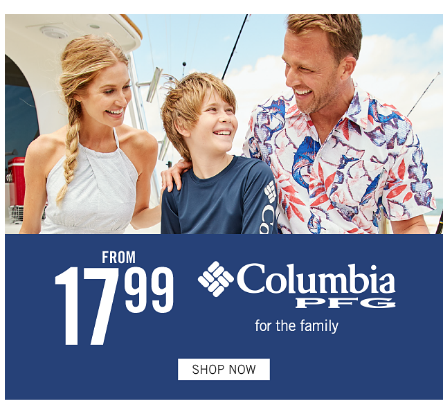 A woman wearing a white sleeveless dress standing next to a boy wearing a blue long sleeved shirt with a white Columbia logo on the sleeve & coral shorts & a man wearing a multi colored print short sleeved button front shirt & light blue shorts. From $17.99 Columbia P F G for the family. Shop now.