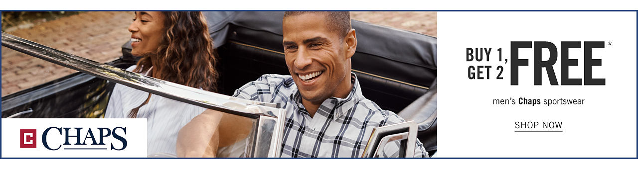 A woman wearing a white top sitting in a convertible next to a man wearing a white & navy plaid short sleeved button front shirt. Buy 1, Get 2 Free men's Chaps sportswear. Shop now.