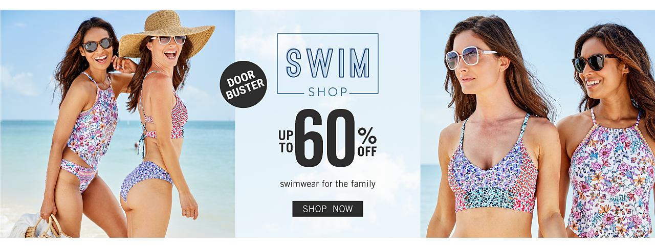 A woman wearing sunglasses & a multi colored print two piece swimsuit standing next to a woman wearing a sun hat, sunglasses & a multi colored print bikini. Doorbuster. Swim Shop. Up to 60% off swimwear for the family. Shop now.