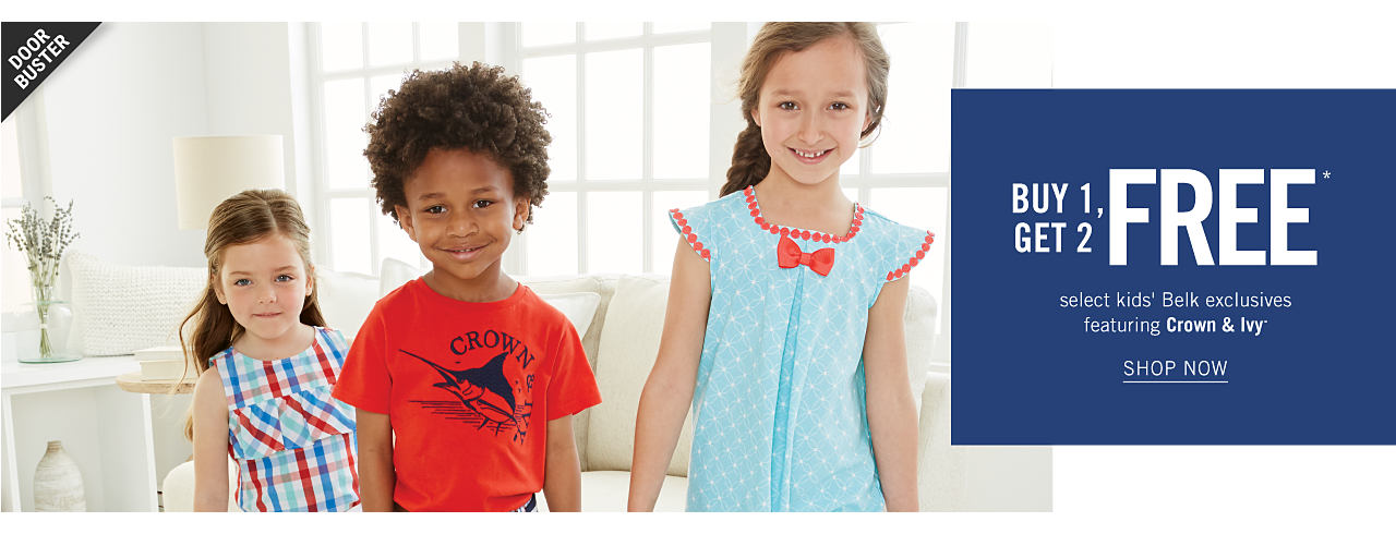 A girl wearing a red, white & blue plaid sleeveless dress standing next to a boy wearing a red T shirt with a black front fishing graphic & as girl wearing a light blue sleeveless dress with a white dot patterned print & red bow & trim. Buy 1, Get 2 Free select kids Belk exclusives featuring Crown & Ivy. Shop now.