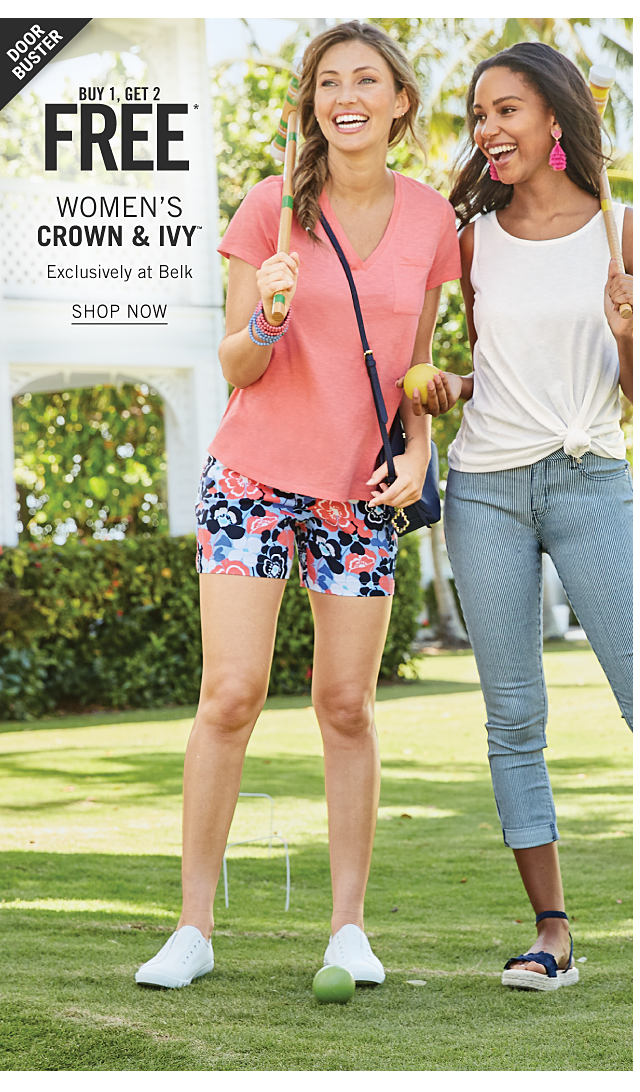 A woman wearing a coral short sleeved top, multi colored floral print shorts & white sneakers standing next to a woman wearing a white tank top, denim capris & navy strappy flat sandals. Doorbuster. Buy 1, Get 2 Free women's Crown & Ivy. Exclusively at Belk. Shop now.