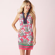 A woman wearing a multi colored paisley print sleeveless dress. Shop Crown & Ivy.