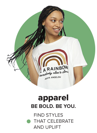 A woman in a white graphic tee. Apparel. Be bold. Be you. Find styles that celebrate and uplift.