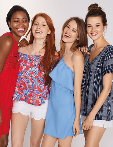 Young women wearing summer dresses, printed tops and shorts.