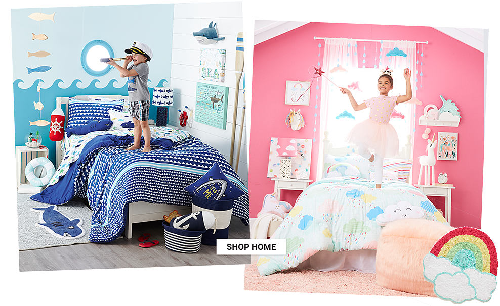 A girl wearing a tiara & a pink princess dress standing on a bed made with a multi colored cloud print comforter & multi colored rainbow print pillows. Dream Room. Bedding & decor to inspire any imagination. Shop home.