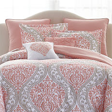 A bed made with a printed comforter and pillows to match. Shop bed in a bag.