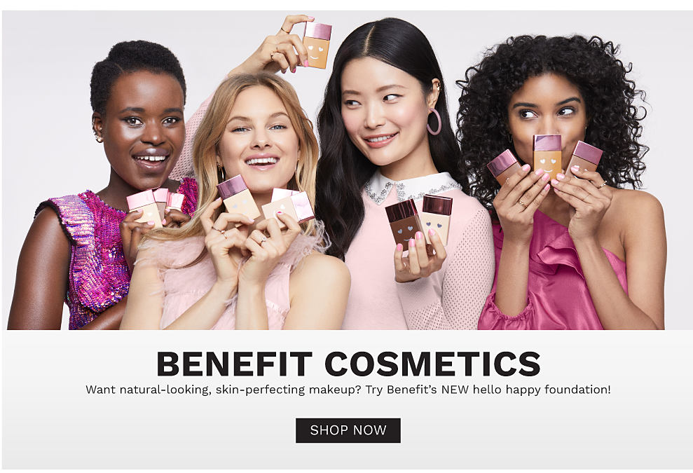 4 women with different skin tones holding a variety of foundation shades. Benefit cosmetics. Want natural looking, skin perfecting makeup? Try Benefit's new hello happy foundation! Shop now.