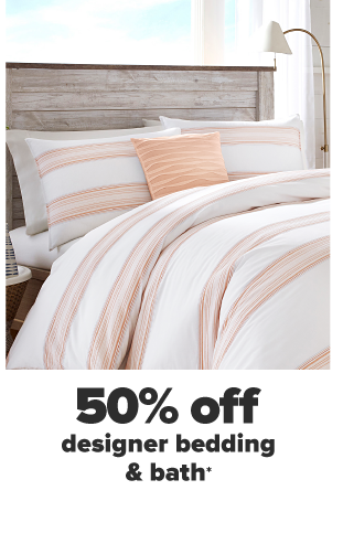 A white and peach striped bedding set with a peach colored decor pillow. 50% off designer bedding and bath.