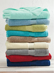 A stack of colorful bath towels. Shop bath towels.