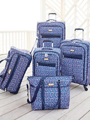 A five piece blue print luggage set. Shop luggage.