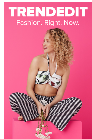 A woman in a white floral halter top and black and white striped pants. Trend Edit. Fashion right now.