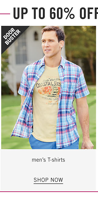 A man wearing a pink, blue & white plaid short sleeved button front shirt over a yellow T shirt with a multi colored front graphic &* light blue shorts. Doorbuster. Shop men's T shirts.