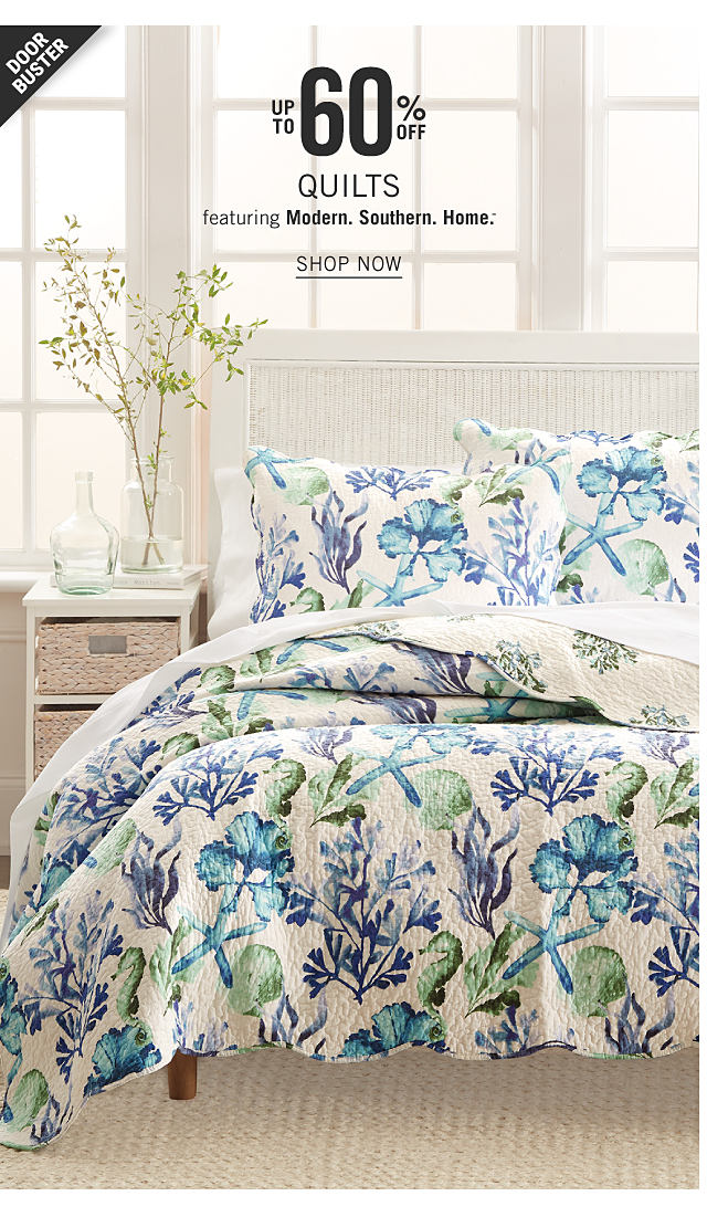 A bed made with a blue, white & green floral print comforter & matching pillows. Doorbuster. Up to 60% off quilts featuring Modern Southern Home. Shop now.