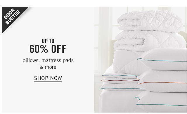 Stacks of white pillows & folded mattress pads on top of a white mattress. Doorbuster. Up to 60% off pillows, mattress pads & more. Shop now.