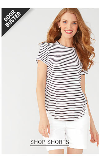 A woman wearing a white & navy horizontal striped short sleeved top & white shorts. Doorbuster. Up to 50% off women's shorts & capris from Gloria Vanderbilt, Bandolino & more. Shop shorts.