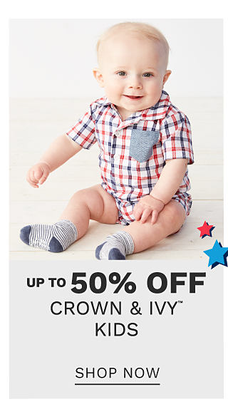 A baby boy wearing a red, white & blue plaid onesie with blue & white horizontal striped socks. Up to 50% off Crown & Ivy kids. Shop now.