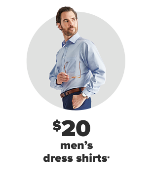 A man in a blue long sleeve button up shirt and dark blue pants. $20 men's dress shirts.