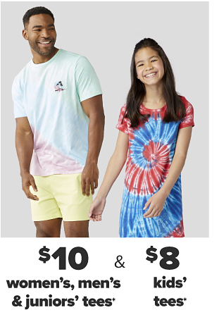 A man in a pastel colored tie dye shirt and yellow shorts. A woman in a tie dye shirt that says living my best life and jean shorts. $10 tees for the family.