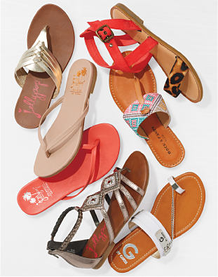 A collection of summer sandals in a variety of styles.