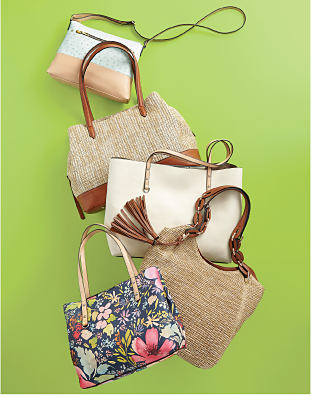 A collection of New Directions handbags.