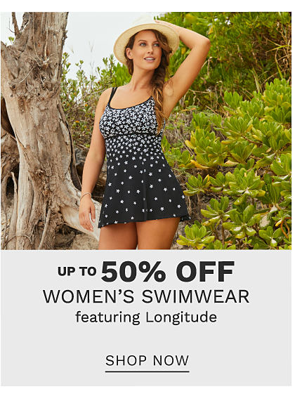 A woman wearing a sun hat & a black 1 piece swimsuit with white dots. Up to 50% off women's swimwear featuring Longitude. Shop now.