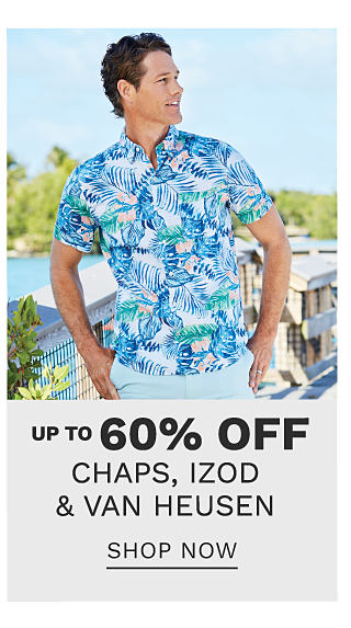 A man wearing a multi colored tropical print short sleeved button front shirt & light blue shorts. Up to 60% off Chaps, Izod, Van Heusen. Shop now.