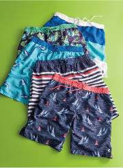 An assortment of swim trunks in a variety of prints. Shop swimwear.