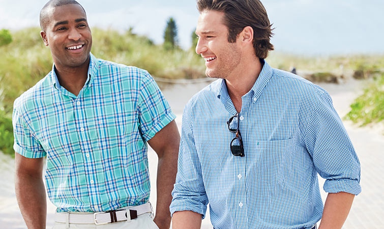 Two men wearing big and tall casual button-front shirts.