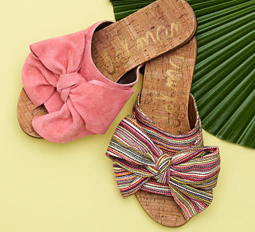 Two pairs of Sam Edelman slide shoes with bow details.