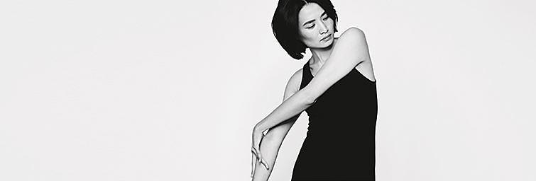 A woman wearing a black dress.