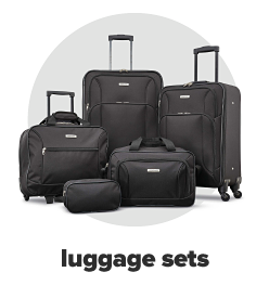 A five piece rolling luggage set in black. Luggage sets