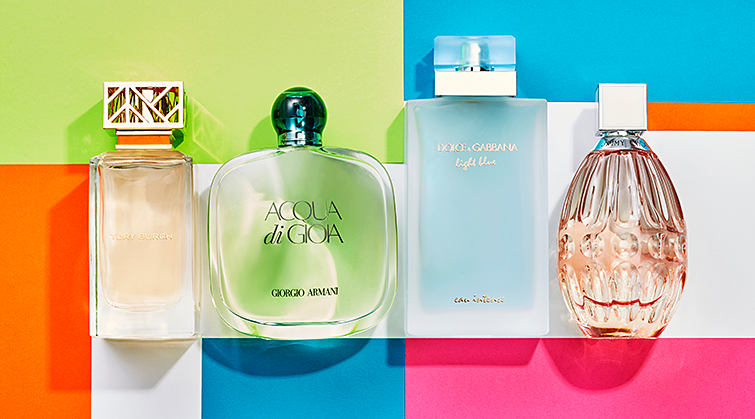 An assortment of summer fragrances on a brightly colored background.