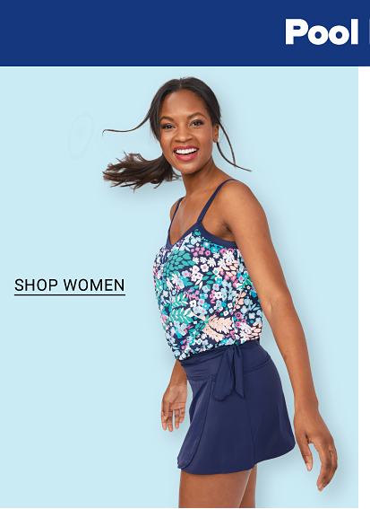 Pool days ahead. Swimwear for the family. A woman in a floral bikini top and navy skirt bathing suit bottom. Shop women.