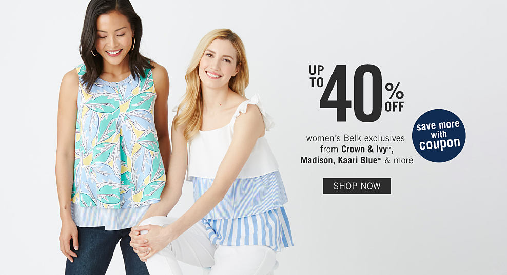 ab6719b13d A woman wearing a multi pastel colored print sleeveless top & blue jeans  standing next to