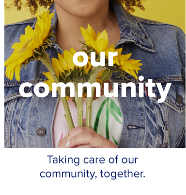 A woman in a denim jacket holding flowers. Our community. Taking care of our community, together.