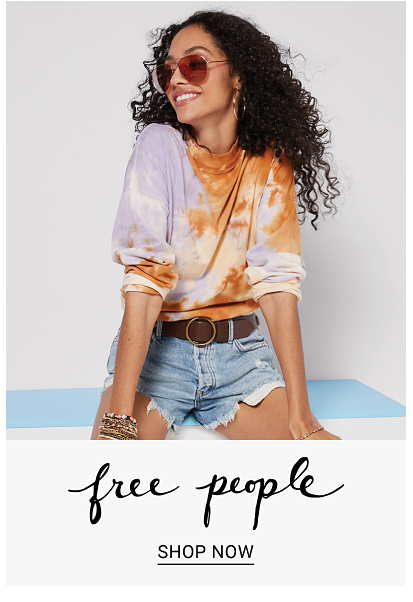 Girl with aviator sunglasses and tie die long sleeve shirt bunched up and ripped denim shorts with brown belt. Free people. Shop now.