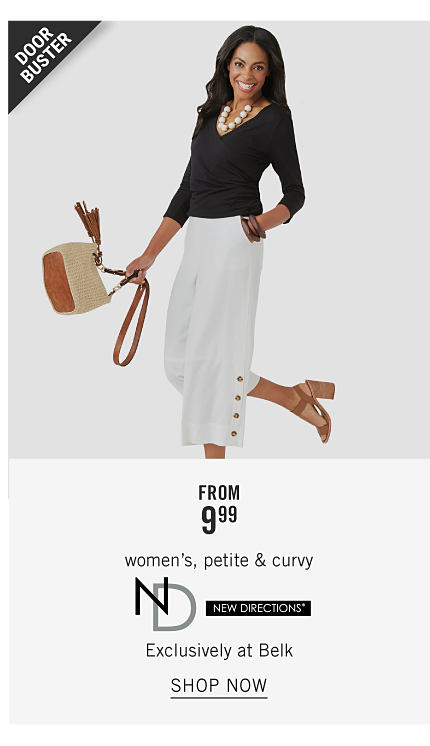 A woman wearing a black long sleeved top, white skirt & brown strappy chunky heeled sandals holding a beige handbag. Doorbuster. From $9.99 women's, petite & curvy New Directions. Exclusively at Belk. Shop now.