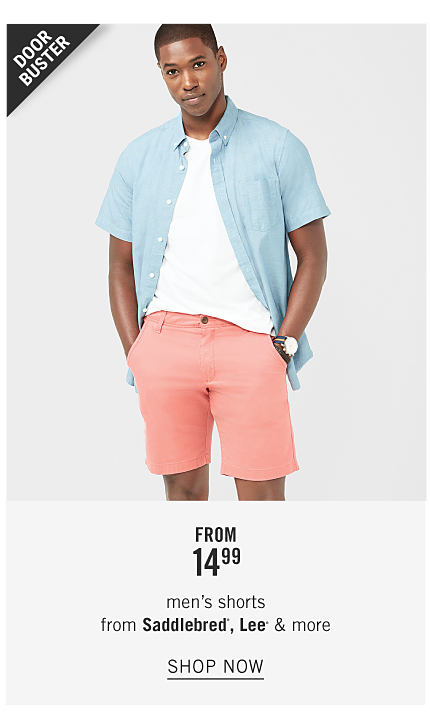 A man wearing a light blue short sleeved button front shirt over a white T shirt & coral shorts. Doorbuster.From $14.99 men's shorts from Saddlebred, Lee & more. Shop now.