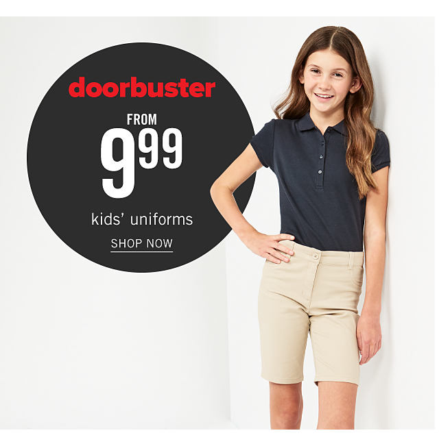 A girl wearing a black polo & beige shorts. Doorbuster. From $9.99 kids uniforms. Shop now.