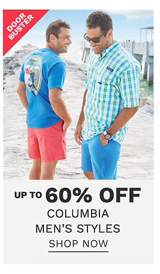 A man wearing a blue T shirt with a multi colored back graphic & coral shorts standing next to a man wearing sunglasses, a green, blue & white plaid short sleeved button front shirt & blue shorts. DoorBuster. Up to 60% off Columbia men's styles. Shop now.