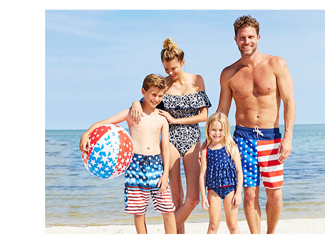 A boy holding a red, white & blue star print beach ball wearing red, white & blue stars & stripes print swim trunks. a woman wearing a black & white print one piece swimsuit, a girl wearing a blue & white print one piece swimsuit & a man wearing red, white & blue stars & stripes print swim trunks. Bonus Buy. Up to 60% off swimwear for the family.